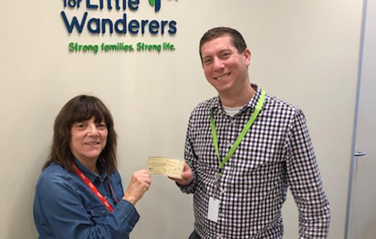NABET 18 Vice President Elizabeth Miller, presents a check to Solomon Rosenberg of The Home for Little Wanderers